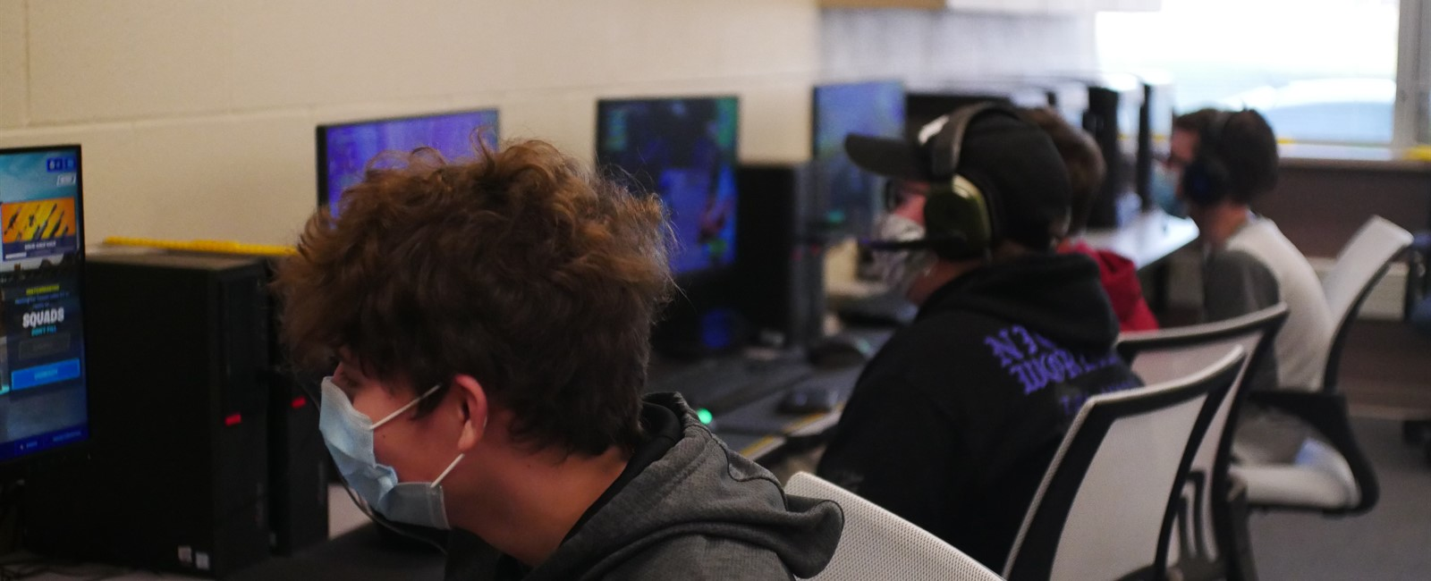 Four students playing esports