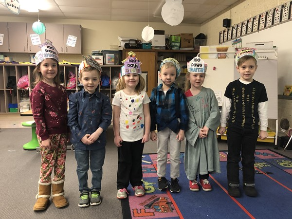 Kindergarten students created special hats for the 100th day.
