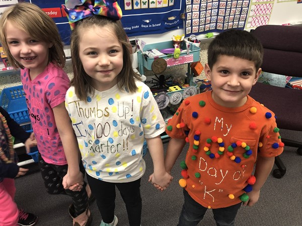 Students created special shirts for the 100th day.
