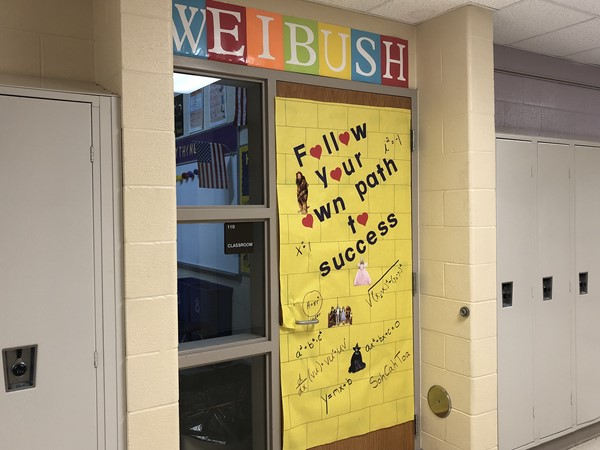 Students can see positive messages on teachers' doors throughout the hallways.