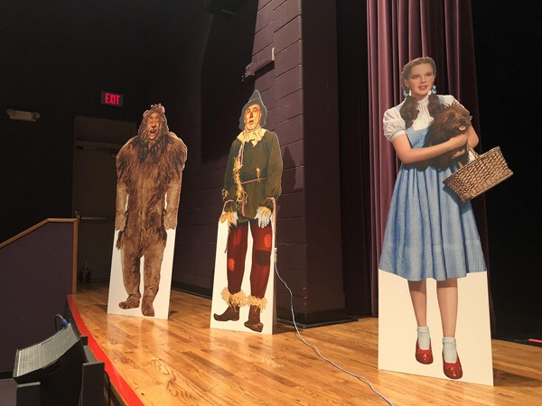 """Wizard of Oz"" characters stand inside the school to show the students there is ""no place like home."""