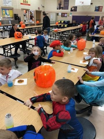 Students in their costumes in the cafeteria