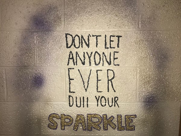 A painting reads Don't let anyone ever dull your sparkle.