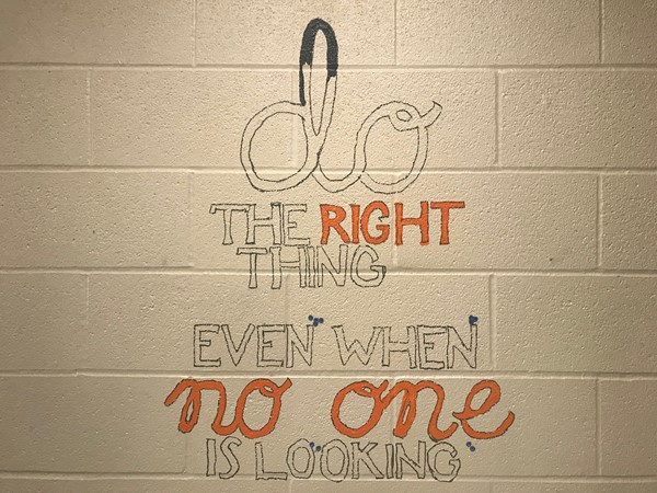 A painting says Do the right thing even when no one is looking.