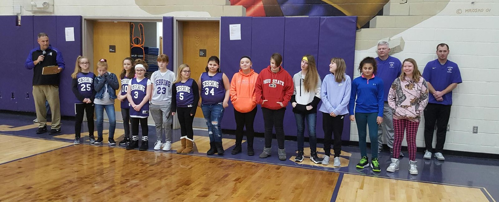 The elementary girls basketball players were recognized during a high school girls basketball game.
