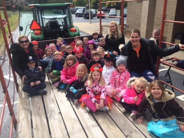 Students smile for a photo while on the hayless hayride.