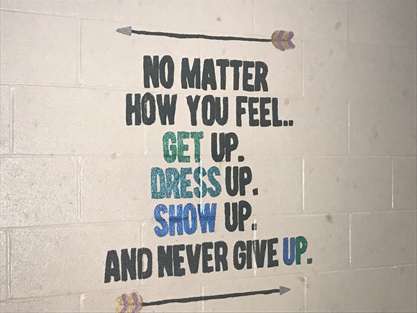 A painting says No matter how you feel..get up. Dress up. Show up. And never give up.